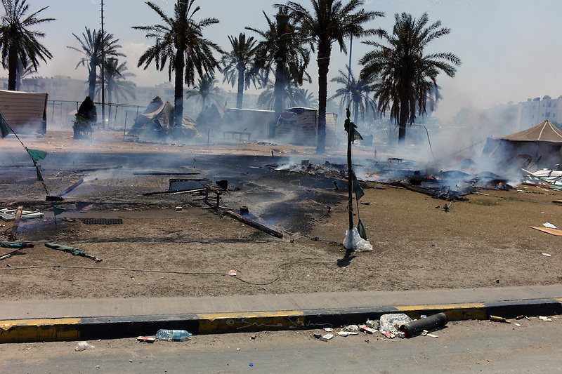 Tripoli, Libya, August 25, 2011.Supporters tents outside Khaddafi's Bab Aziziya compound, now entirely in the hands of the rebels, have been burned to the ground.