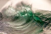 A shorebreak wave at Waimea Bay on the North Shore of O'ahu.