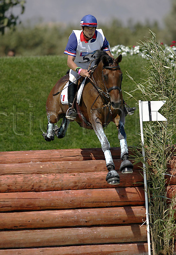 17 August 2004: French rider JEAN TEULERE riding ESPOIR DE LA MARE (FRA) jump a fence on the Cross Country course during the Eventing Competition at the 2004 Olympic Games in Athens, Greece. Photo: Neil Tingle/Action Plus...equestrian horses olympics 040817 riders fences three day event