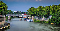 Fine, Art, Print, Photograph, of the Tiber, River. The curved road and colourful blue sky Frame the bridge,
