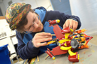 Santa Monica College art student Jarryd Vanzyl, 24, works on his toy sculpture during the  .6th Annual Santa Monica Airport Artwalk on Saturday, March 17, 2012.