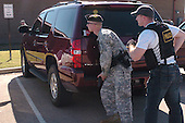 Fort Hood, TX - November 5, 2009 -- Post police take cover when a gunman fires shots at the Soldier Readiness Processing Center on Fort Hood, Texas, Thursday, November 5, 2009. .Mandatory Credit: Andrew Evans - U.S. Army via CNP