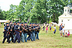 Old Bethpage, New York, USA - July 21, 2012: During miliary maneuvers, troops joke around by pointing their rifles with attached bayonets as they run toward visitors, at re-creation of life at Camp Scott, a Union Army training camp, at Old Bethpage Village Restoration, to commemorate 150th Anniversary of American Civil War, on Saturday, July 21, 2012.