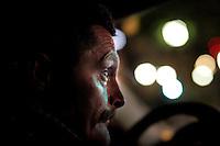 Police officer Stig Gaustad watch Oslo nightlife from an unmarked police car.<br /> <br /> <br /> Stig Gaustad fra Sentrum Politistasjons etteretningsavdeling f&oslash;lger med p&aring; utelivet i Oslo sentrum. . (Foto:Fredrik Naumann/Felix Features)
