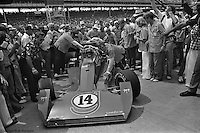 INDIANAPOLIS, IN: AJ Foyt's crew pushes his Coyote 75/Foyt TC to victory lane after he becomes the first four-time winner of the Indianapolis 500 on May 29, 1977.