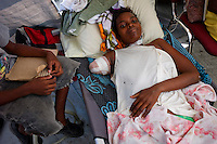 Port Au Prince, Haiti, Jan 23 2010.Naomi Estimat, 27, a mother of 2 has lost her right arm when a wall from her house collapsed on her. The Belgian B-Fast team has set up a field hospital in Delmas 33; 2 surgeons treat victims of heavy traumatisms..