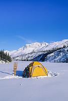 Yellow tent and snowshoes at camp in the Brooks Range, Arctic, Alaska