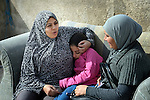 Souad Kasem Issa (left) and her daughter Rahaf, 9, talk with Dhamyah Mahdy Salih on the roof of an apartment building in Amman, Jordan. Souad and her family of eight fled the city of Homs, Syria, as fighting there worsened in 2012. Their home in Syria has since been destroyed by bombing, and they are struggling to survive in Jordan's capital city. Dhamyah, an Iraqi refugee, is a volunteer with International Orthodox Christian Charities, is a member of the ACT Alliance, which has provided some assistance to the family.