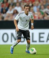 Fussball International  WM Qualifikation 2014   06.09.2013 Deutschland - Oesterreich  Mesut Oezil (Deutschland) am Ball