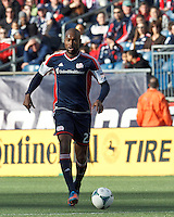 New England Revolution defender Jose Goncalves (23) brings the ball forward. .  In a Major League Soccer (MLS) match, FC Dallas (red) defeated the New England Revolution (blue), 1-0, at Gillette Stadium on March 30, 2013.