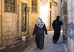 Muslim women in an alley of the old city of Urfa, or Sanliurfa, in southeastern Turkey.<br />