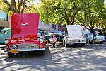Three Ford Thunderbirds are lined up for the car show at the Los Altos Fall Festival.