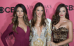 Victoria's Secret Angels Lily Aldridge, left, Alessandra Ambrosio and Miranda Kerr pose for photos on the Pink Carpet before Tuesday's screening party for the 2011 Victoria's Secret Fashion Show.