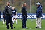 05 November 2008: UNC head coach Anson Dorrance (left) with volunteer assistant coach Cindy Parlow (center) and assistant coach Bill Palladino (right). The University of North Carolina defeated the University of Miami 1-0 at Koka Booth Stadium at WakeMed Soccer Park in Cary, NC in a women's ACC tournament quarterfinal game.