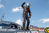 Sep 5, 2016; Clermont, IN, USA; NHRA top alcohol funny car driver Jonnie Lindberg celebrates after winning the US Nationals at Lucas Oil Raceway. Mandatory Credit: Mark J. Rebilas-USA TODAY Sports