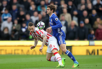 Stoke City's Marko Arnautovic battles with Chelsea's Marcos Alonso<br /> <br /> Photographer Mick Walker/CameraSport<br /> <br /> The Premier League - Stoke City v Chelsea - Saturday 18th March 2017 - bet365 Stadium - Stoke<br /> <br /> World Copyright &copy; 2017 CameraSport. All rights reserved. 43 Linden Ave. Countesthorpe. Leicester. England. LE8 5PG - Tel: +44 (0) 116 277 4147 - admin@camerasport.com - www.camerasport.com