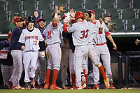 Cord Sandberg (32) of the Lakewood BlueClaws is congratulated by his teammates after hitting a game-tying home run with two outs in the top of the ninth inning against the Kannapolis Intimidators at Kannapolis Intimidators Stadium on April 8, 2017 in Kannapolis, North Carolina.  The BlueClaws defeated the Intimidators 8-4 in 10 innings.  (Brian Westerholt/Four Seam Images)