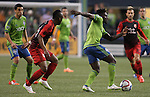 Seattle Sounders Obafemi Martins (9) controls the ball away from  Portland Timbers Ishmael Yartey(18) during an MLS match on April 26, 2015 at CenturyLink Field in Seattle, Washington.  Seattle Sounders Clint Dempsey scored a goal to give the Sounders a 1-0 victory over the Timbers. Jim Bryant Photo. ©2015. All Rights Reserved.