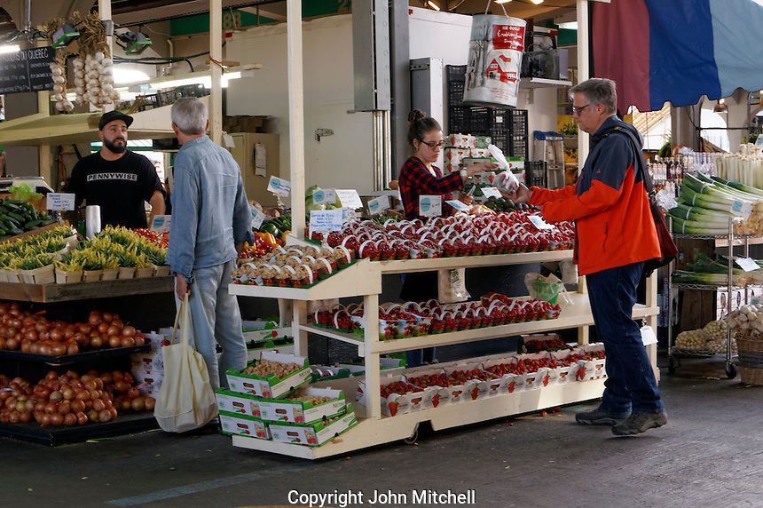 People at a fruit and vegetable stand at Jean Talon Market, Montreal, Quebec, Canada