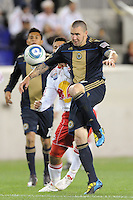 Danny Califf (4) of the Philadelphia Union plays the ball in front of Connor Chinn (25) of the New York Red Bulls. The New York Red Bulls defeated the Philadelphia Union 2-1 during a US Open Cup qualifier at Red Bull Arena in Harrison, NJ, on April 27, 2010.