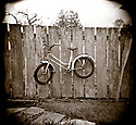 PL10306-00...WASHINGTON - Holga image of a bicycle on fence. this was located on Orcas Island of the San Juan Islands Group.
