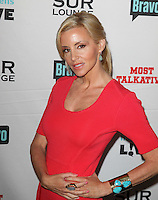 Camille Grammer.Bravo's Andy Cohen's Book Release Party For &quot;Most Talkative: Stories From The Front Lines Of Pop Held at SUR Lounge, West Hollywood, California, USA..May 14th, 2012.half length red dress gold turquoise bracelet cuff hand on hip.CAP/ADM/KB.&copy;Kevan Brooks/AdMedia/Capital Pictures.