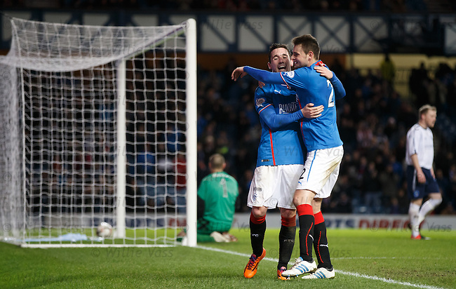 Nicky Clark celebrates his fourth goal of the match with Seb Faure
