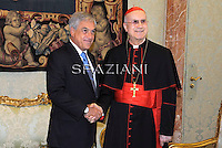 Cardinal Tarcisio Bertone , during a meeting Chilean President Sebastian Pinera (L) and his wife Cecilia Morel (R) during a private audience at the Vatican, 03 March 2011