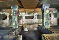 Interior of the Tomb of Reliefs that has everyday Etruscan objects carved into the volcanc Tuff rock, as well as separate burial chambers with rock pillows,4th century BC,  Necropoli della Banditaccia, Cerveteri, Italy. A UNESCO World Heritage Site