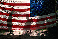 Reflections on an American flag at a camp site along the St Marys River.