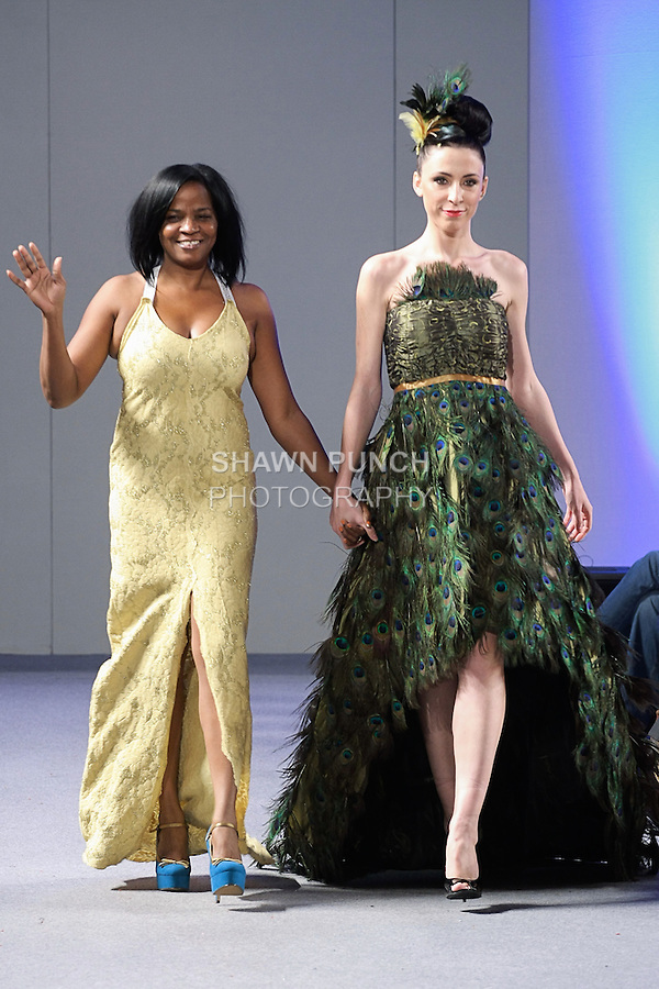 Fashion designer Arthlene Laudat Legair walks runway with model at the close of her LeGair Brand collection fashion show, during Couture Fashion Week New York Spring 2013, on September 17, 2012.