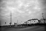 A train containing trailers for the displaced residents of hurricane Katrina passes through the 9th Ward of New Orleans.