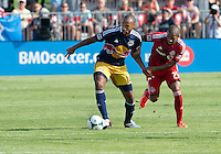 20 July 2013: New York Red Bulls forward Thierry Henry #14 and Toronto FC defender Jeremy Hall #25 in action during an MLS regular season game between the New York Red Bulls and Toronto FC at BMO Field in Toronto, Ontario Canada.<br /> The game ended in a 0-0 draw.