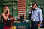 Reporters Felicia Sonmez, left, of the Washington Post and Chris Moody of Yahoo! News test a tin can phone at a &quot;Roundtable On Entrepreneurship&quot; with Republican vice presidential candidate Rep. Paul Ryan at University of South Florida in Tampa, Florida, October 19, 2012.