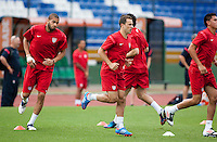(Left to right) Oguchi Onyewu and Steve Cherundolo go through some warm up routines at Estadio Mateo Flores in Guatemala City, Guatemala on Mon. June 11, 2012.  The USA will face Guatemala in a World Cup Qualifier on Tuesday.