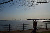 People relax along the hudson River in New Jersey , April 06, 2013. today was the first time since October. VIEWpress /Kena Betancur