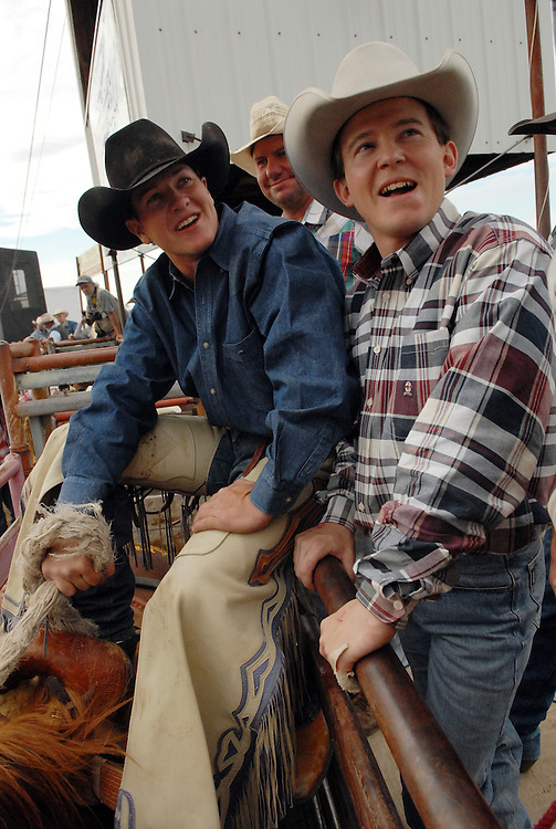 Rider Shane Moran, left, waits to ride a bronco at the Bucking Horse Sale in Miles City, Montana.