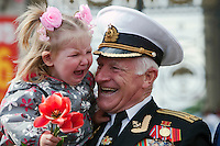 Moscow, Russia, 09/05/2011..A girl bursts into tears after being handed to a veteran as Russian World War Two veterans and well-wishers gather in Gorky Park during the country's annual Victory Day celebrations.