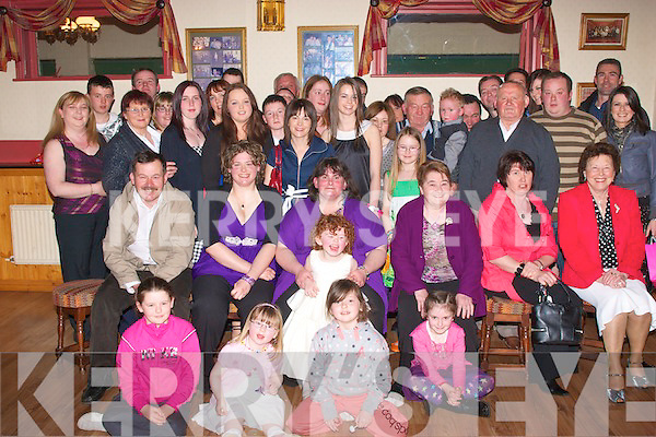 1374-1378.Key to the Door: Tracey Horgan(seated 2nd from the Lt)Leith Cross Tralee,celebrated her 21st last Saturday night in the John Mitchells GAA club house JohnJoe RD Tralee with her parents Lisa&Ted,sisters Elaine&Niamh and many family and friends.