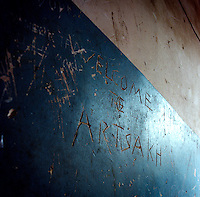 """welcome to Artsakh"" written on the wall of a building in Stepanakert."