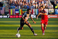 Sheanon Williams (25) of the Philadelphia Union is marked by Marco Pappa (16) of the Chicago Fire. The Chicago Fire defeated the Philadelphia Union 3-1 during a Major League Soccer (MLS) match at PPL Park in Chester, PA, on August 12, 2012.