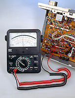 ANALOG MULTIMETER<br /> (Variations Available)<br /> Used as Voltmeter<br /> Testing voltage on stereo amplifier board. Reads approximately 42 volts.