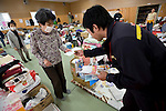 Postman Yoshinori Shoji delivers a letter to a resident left homeless by the March 11 quake and tsunami at the Kadonowaki Junior High School in Ishinomaki, Miyagi Prefecture, Japan on Tuesday 24 May 2011..Photographer: Robert Gilhooly