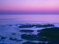 769550002 the sky turns soft pink and blue and is reflected in the coastal surf of the pacific ocean just after sunset along the central oregon coast