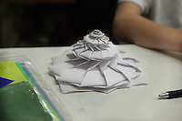 New York, NY, USA - June 23, 2012: Jack O'Donnell, from New Jersey, displays a model he folded at the OrigamiUSA 2012 convention held at Fashion Institute of Technology in New York City. This spiral model, a Flower Tower, original design by Chris Palmer, unfolds in an elastic manner.