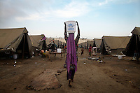 A girl makes her way through a camp for people displaced by the floods in Sukker, Sindh Province, Pakistan.