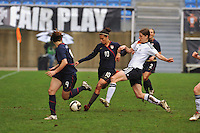 Carli Lloyd fends off a German tackler.  The USA captured the 2010 Algarve Cup title by defeating Germany 3-2, at Estadio Algarve on March 3, 2010.
