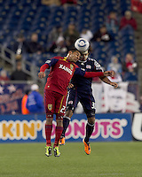 Real Salt Lake forward Paulo Araujo Jr. (23) and New England Revolution defender Kevin Alston (30) battle for head ball. In a Major League Soccer (MLS) match, Real Salt Lake defeated the New England Revolution, 2-0, at Gillette Stadium on April 9, 2011.