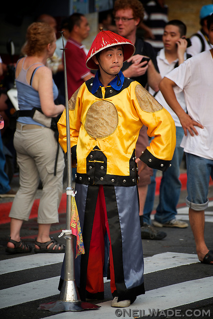 A parader waits for the start of the 2011 Keelung Ghost Festival Parade.