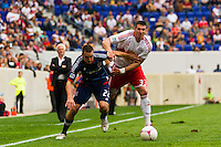 Austin Berry (22) of the Chicago Fire battles Kenny Cooper (33) of the New York Red Bulls for the ball. The Chicago Fire defeated the New York Red Bulls 2-0 during a Major League Soccer (MLS) match at Red Bull Arena in Harrison, NJ, on October 06, 2012.